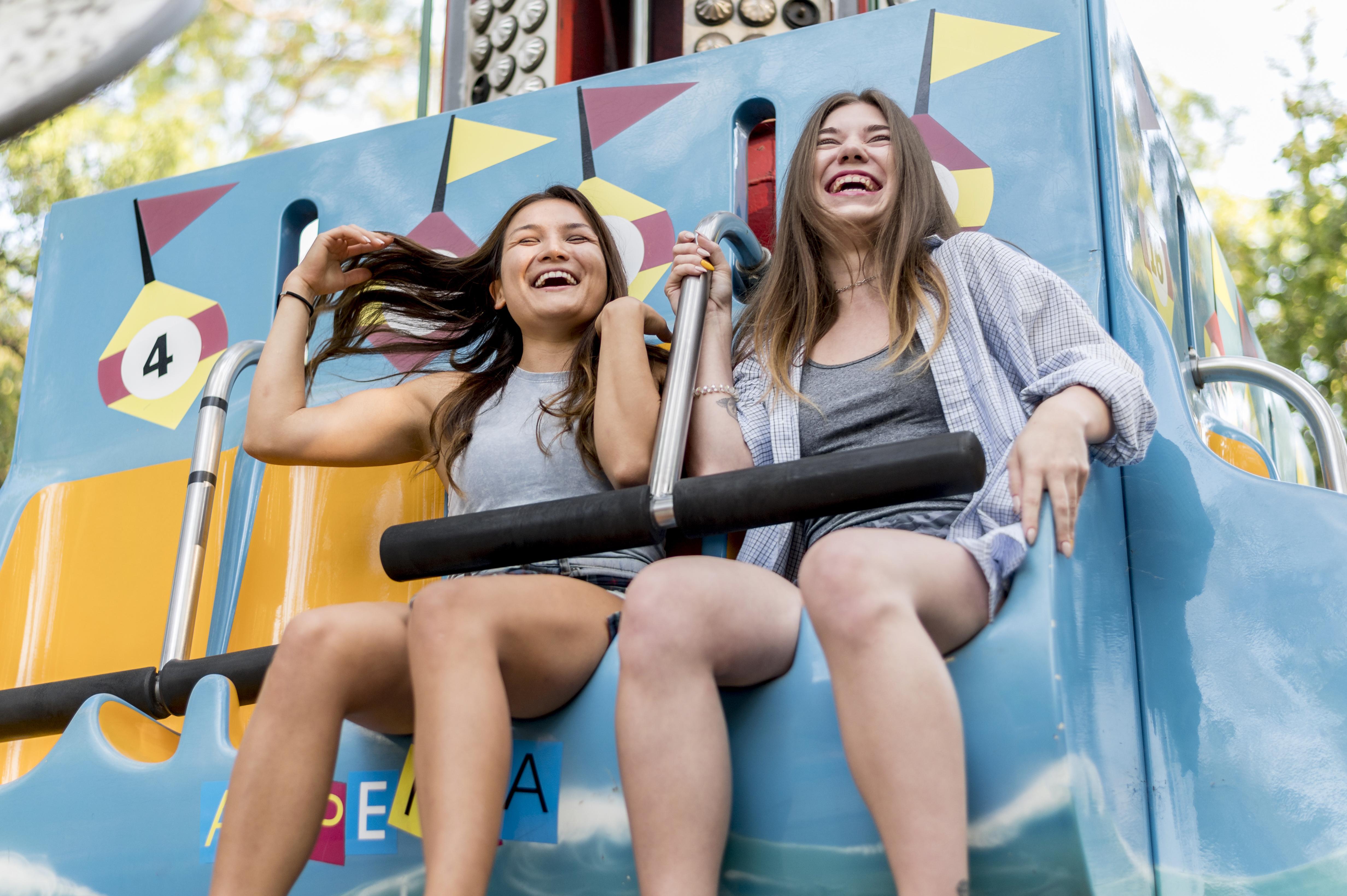 female-friends-having-fun-amusement-park